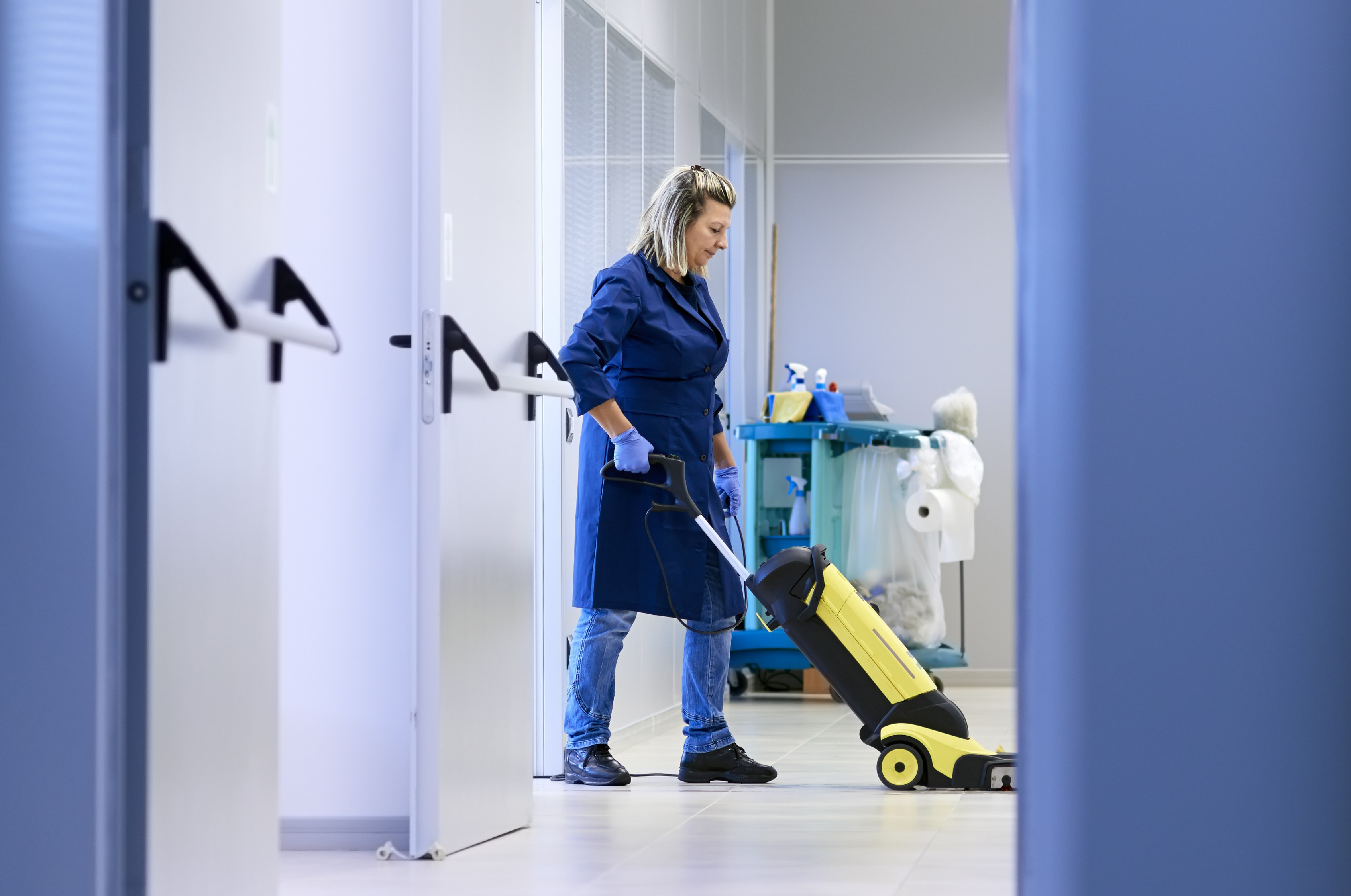 Cleaning lady with floor machine