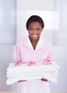 girl holding towels